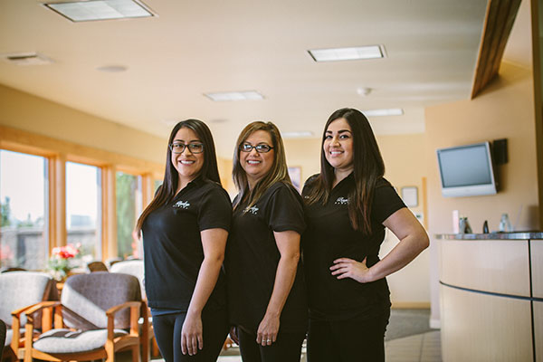Smiling dental team at dentist office in Pasco, WA