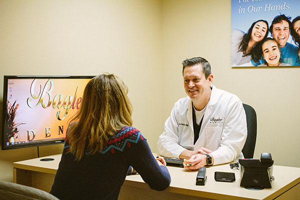 W. Ryan Bagley, DDS speaking with a patient at his dental office in Pasco, WA